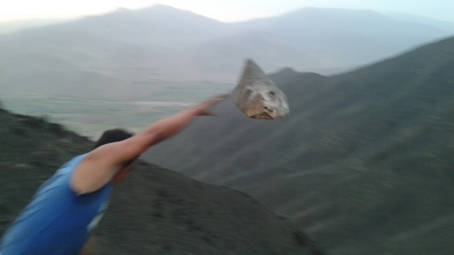 Roiser throwing rocks from the top of the mountain